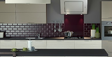 image of a kitchen with a grey and partial red tiling theme